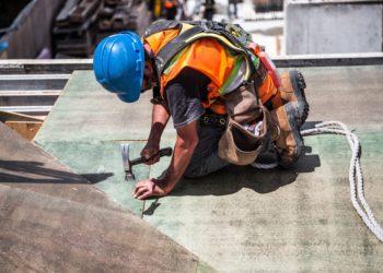 man-wearing-blue-hard-hat-using-hammer-544966